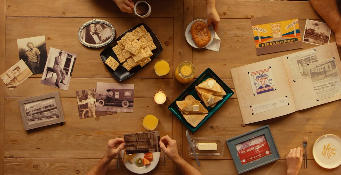Top down photo of a table with snacks and framed photos representing the history of Summit Hill Foods